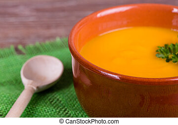 pumpkin soup - Bowl of pumpkin soup with parsley on wooden...