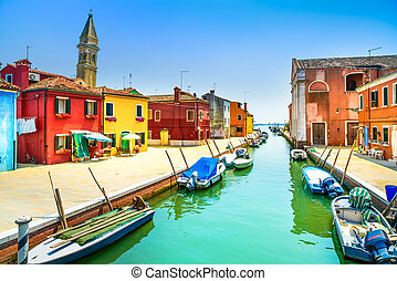Venice landmark, Burano island canal, colorful houses, church and boats, Italy