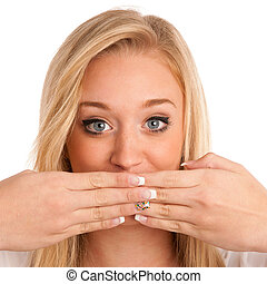 Cute young woman gesturing silence