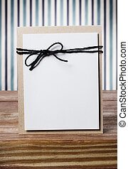 Hand crafted blank card on a striped background - Vintage...