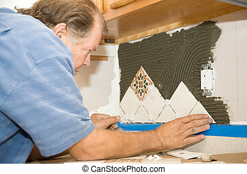 Tile Worker Sets Tile - Tile worker setting tiles in mortar...