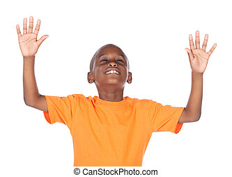 Cute african boy wearing a bright orange t-shirt. The boy is...