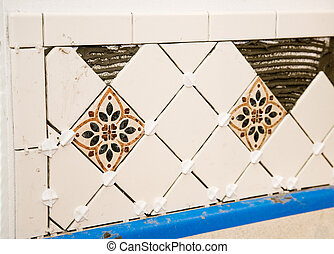 Ceramic Tile Wall - Ceramic tiles laid out on a wall with...