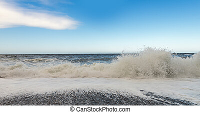 Waves wash over pebbles (Cape Breton, Nova Scotia, Canada)