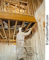 Worker Blowingr Polyurethane Foam - Working blowing...