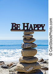 "Sign ""Be Happy"" on balanced rocks - Sign ""Be happy"" on the..."