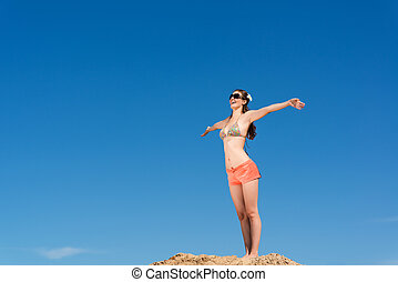 young woman on a background of blue sky