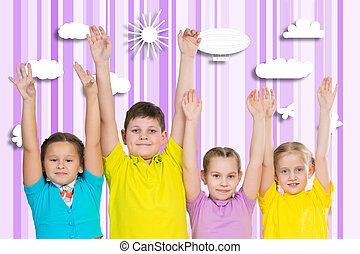 children stand in a row and hands up