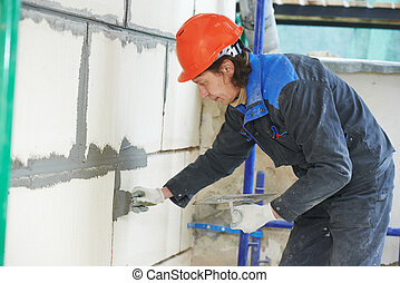 facade builder plasterer at work
