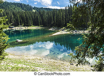 Carezzas lake colors in summer season - reflections in the...
