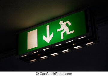 Exit - Emergency exit sign glowing green in the dark