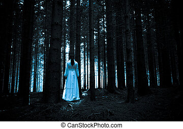 Woman with long black hair in white dress in the spooky dark...