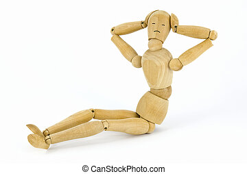 Push-ups - Sitting wooden toy man on a white background as a...