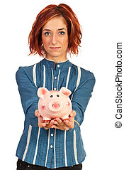 Corporate woman offering piggybank isolated on white...