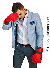 Stressed business man with boxing gloves loss competition...