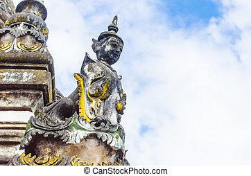 A sphinx guard the Burmese temple