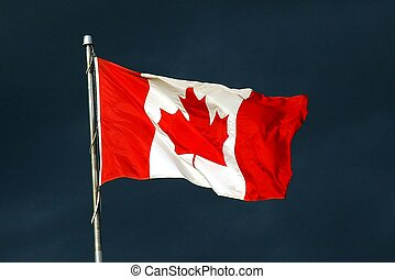 Pride - Canadian flag in front of dark sky