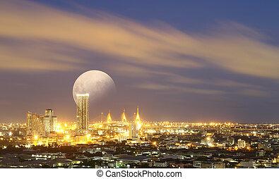 Big moon over Bangkok cityscape,aerial view