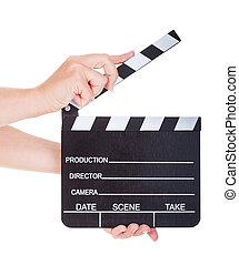 Hand Holding Clapperboard On White Background - Close-up Of...
