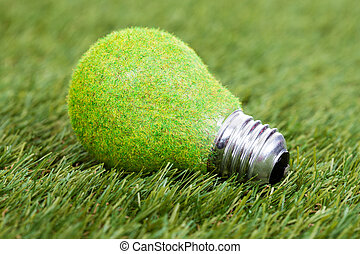 Energy Saving Bulb On Green Grass - Close-up Of Energy...