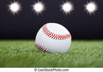 White Baseball - Baseball On Grass Field With Light In The...