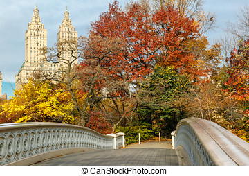 Display of autumn colors by the Bow Bridge in Central Park,...