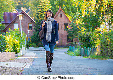 Beautiful trendy young woman in stylish clothing with a warm...