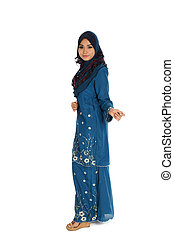 Pretty young Asian Muslim woman posses beautiful in action. Islamic fashionable attire concept