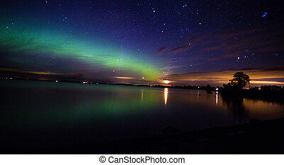 Northern Lights over the lake in Sweden