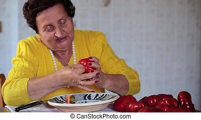 Senior Woman Cooking - Footage of senior woman removing core...