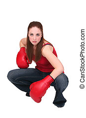 boxer girl - one young girl boxing with big red gloves over...