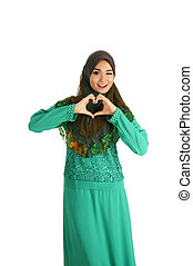 Pretty young Asian Muslim woman with love sign in action....