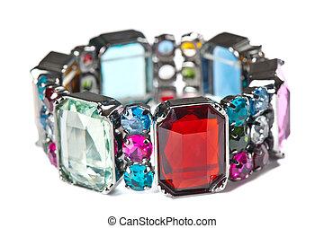 Colorful bracelet on white background. Shallow DOF.