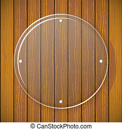 Round glass plate on the background of wooden wall
