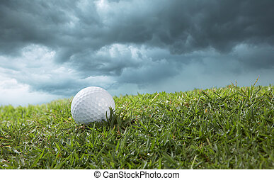 golf ball on course with cloudy sky