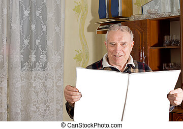 Retired man enjoying his newspaper - Retired elderly man...