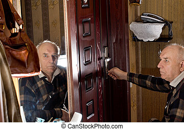 Disabled man locking a door - Disabled elderly man in a...