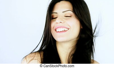 Happy woman blowing long hair smile