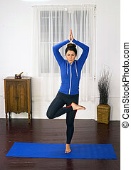 Young Attractive Woman Stands Tree Pose Blue Mat Yoga Dance