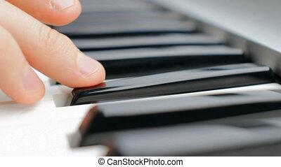 Playing Piano - Hand of a pianist playing on synthesizer