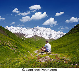 Tourist in the mountains of the Caucasus - Summer landscape...