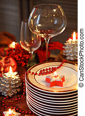 Plates and empty glasses on the Chistmas table - Christmas...