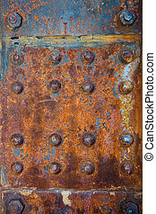 Rivets - Rusty rivets on a steel panel