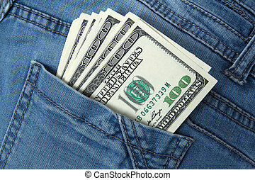 one hundred dollar bills in jeans pocket