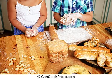 Children cooking homemade pastry