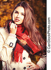 seasonal beauty - Beautiful young woman at the autumn park