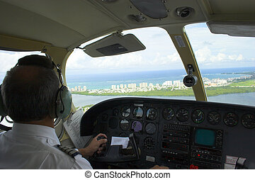 Pilot in the plane - Small plane pilot flying and landing...