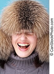 Cold weather fashion. Smiling young woman close up.