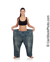 Slim woman with huge pants isolated on a white background
