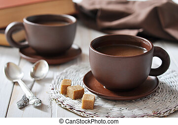 two cups of coffee on wooden background